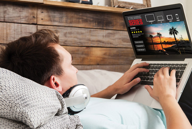 Teen watching shows on Laptop
