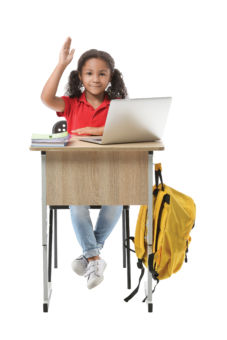 young girl using laptop raising hand sitting in desk